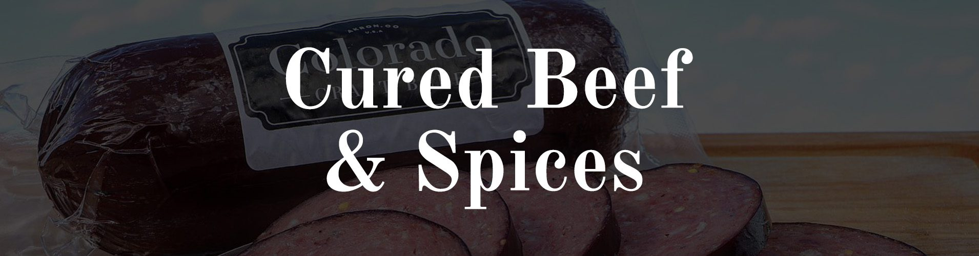 Colorado Craft Beef summer sausage with an overlay saying Cured Beef & Spices