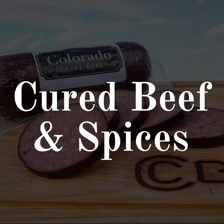 Cured Beef & Spices - white text on overlay on picture of summer sausage