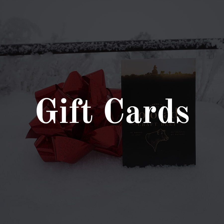 Colorado Craft Beef gift card with red shiny bow in the snow