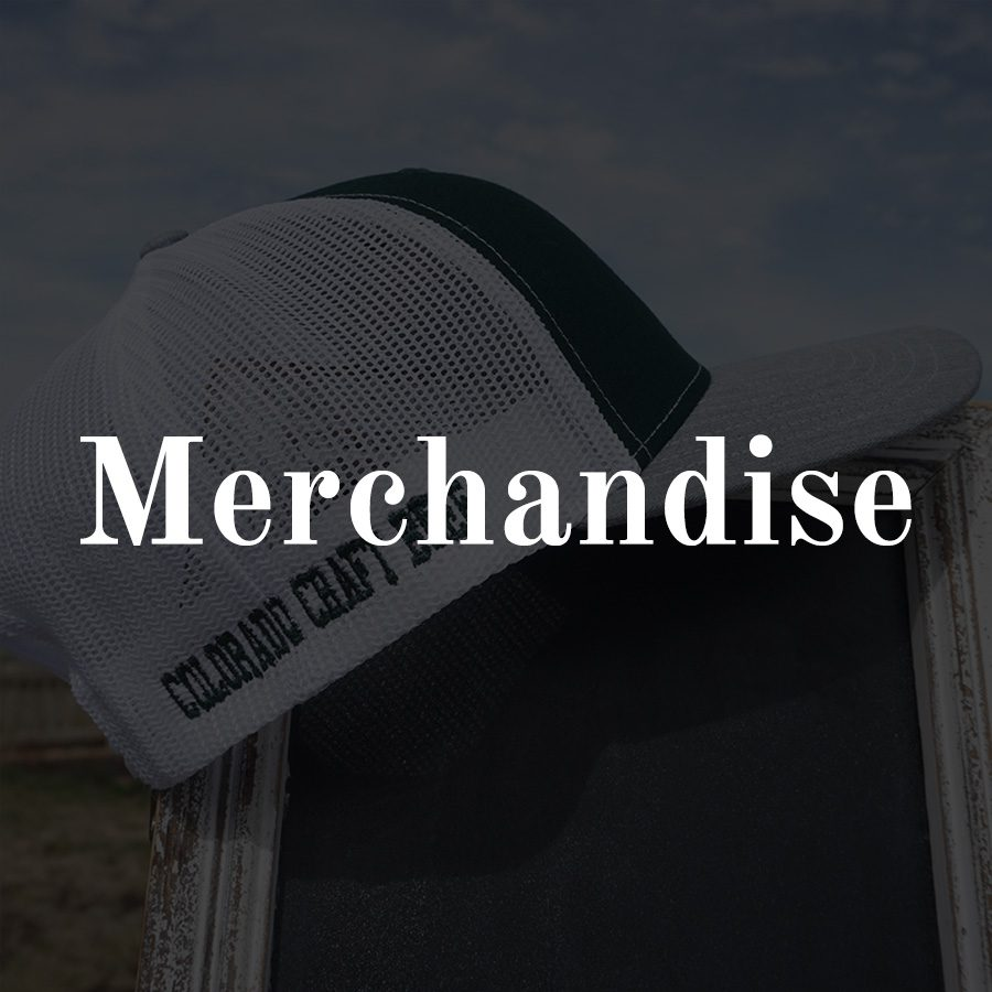 Merchandise - white text on overlay on photo of a ball cap